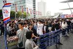 Fans wait in line to purchase team merchandise outside Saitama Super Arena in Saitama, near Tokyo before an NBA preseason basketball game between the Houston Rockets and the Toronto Raptors Tuesday, Oct. 8, 2019. (AP Photo/Jae C. Hong)