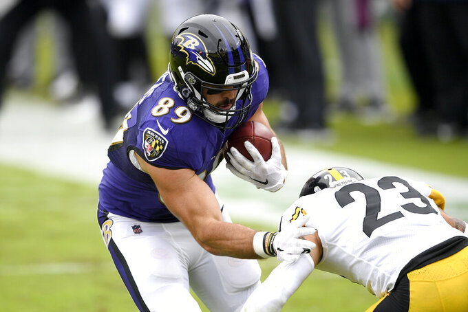 Baltimore Ravens tight end Mark Andrews (89) prepares to take a hit from Pittsburgh Steelers cornerback Joe Haden (23) during the first half of an NFL football game, Sunday, Nov. 1, 2020, in Baltimore. (AP Photo/Nick Wass)