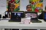 In this undated photo, High Hills Elementary School fifth-graders Deanna Robinson, left, and Devin Finley show off their work with D&D's Donut Diner at the school on Shaw Air Force Base near Sumter, S.C. (Bruce Mills/The Item via AP)