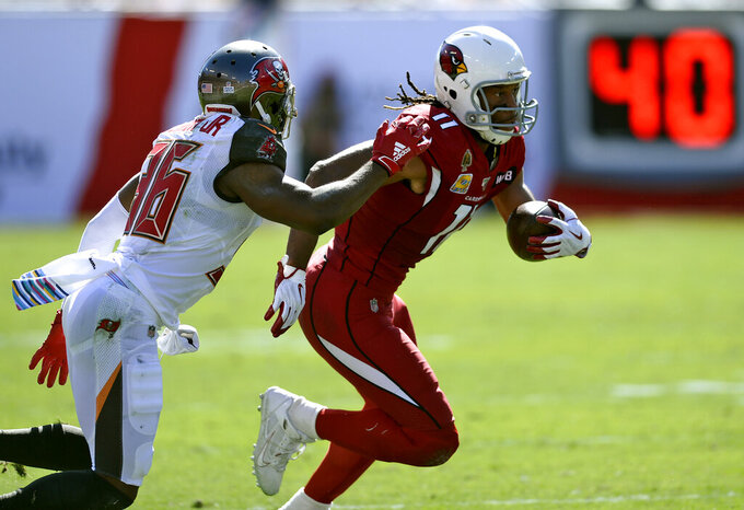 Arizona Cardinals wide receiver Larry Fitzgerald (11) gets past Tampa Bay Buccaneers cornerback M.J. Stewart (36) after a reception during the first half of an NFL football game Sunday, Nov. 10, 2019, in Tampa, Fla. (AP Photo/Jason Behnken)