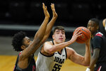 Iowa center Luka Garza drives to the basket ahead of Northern Illinois forward Chinedu Okanu, left, during the first half of an NCAA college basketball game, Sunday, Dec. 13, 2020, in Iowa City, Iowa. (AP Photo/Charlie Neibergall)