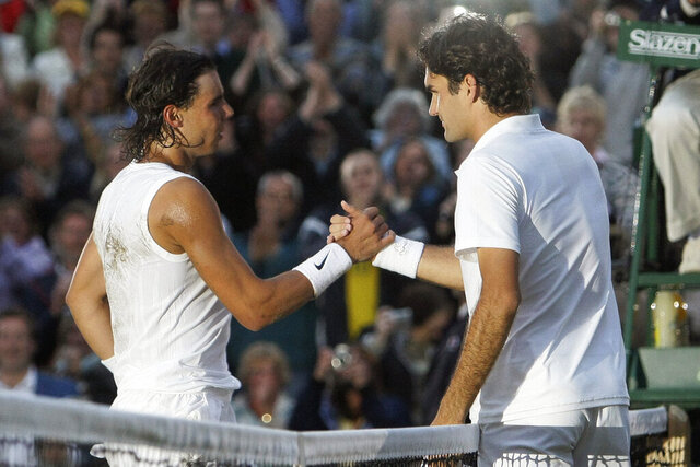 FILE - In this July 6, 2008, file photo, Spain's Rafael Nadal left, shakes the hand of Switzerland's Roger Federer after winning the men's final on the Centre Court at Wimbledon. (AP Photo/Anja Niedringhaus, File)