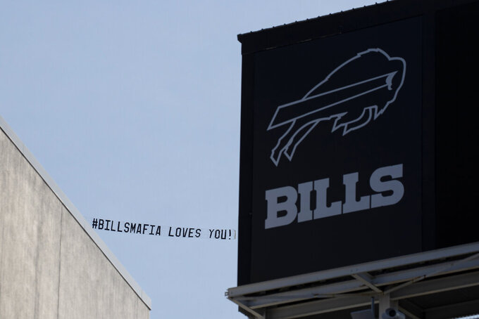 A Buffalo Bills fan funded airplane with a message of support flies overhead Bills Stadium before an NFL football game between the Buffalo Bills and the Los Angeles Rams, Sunday, Sept. 27, 2020, in Orchard Park, N.Y. The Mafia is becoming legitimate in Buffalo — the Bills Mafia that is. The Bills last week filed an application to trademark its fanbase's adopted nickname in preparation to launch a series of branded merchandise and apparel available at its team store and sold online. (AP Photo/Brett Carlsen)