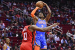 Oklahoma City Thunder guard Shai Gilgeous-Alexander (2) shoots over Houston Rockets guard James Harden (13) during the first half of an NBA basketball game, Monday, Jan. 20, 2020, in Houston. (AP Photo/Eric Christian Smith)
