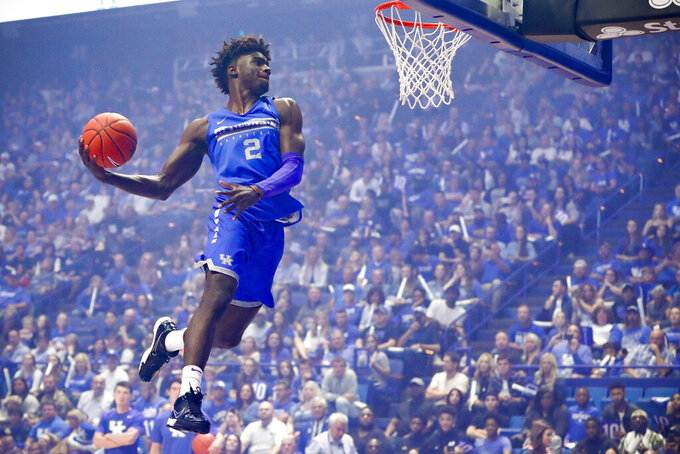 Kentucky forward Kahlil  Whitney goes up for a dunk during the NCAA college basketball team's Big Blue Madness at Rupp Arena in Lexington, Ky., Friday, Oct. 11, 2019. (Alex Slitz/Lexington Herald-Leader via AP)