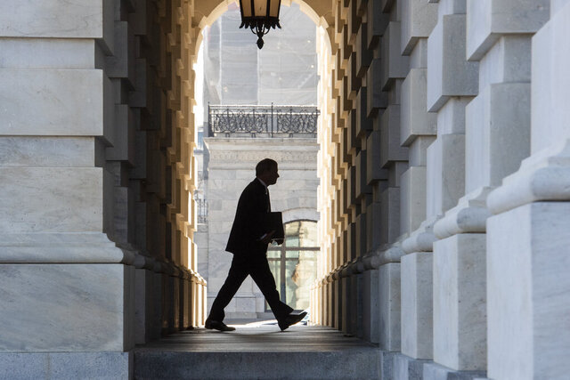 Supreme Court Chief Justice John Roberts arrives at the Capitol in Washington, Tuesday, Jan. 21, 2020. President Donald Trump's impeachment trial quickly burst into a partisan fight Tuesday as proceedings began unfolding at the Capitol. Democrats objected strongly to rules proposed by the Republican leader for compressed arguments and a speedy trial. (AP Photo/Cliff Owen)