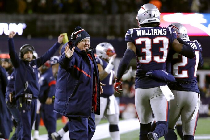 New England Patriots head coach Bill Belichick, left, celebrates after defensive back J.C. Jackson, far right, knocked down a pass in the end zone intended for Buffalo Bills wide receiver Cole Beasley in the second half of an NFL football game, Saturday, Dec. 21, 2019, in Foxborough, Mass. (AP Photo/Elise Amendola)