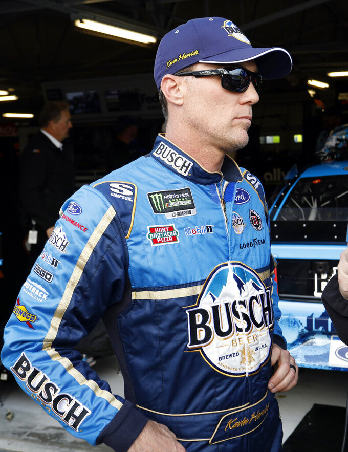 Kevin Harvick stands outside his garage after qualifying for the NASCAR Cup Series auto race at Kansas Speedway in Kansas City, Kan., Friday, May 10, 2019. Harvick won the pole. (AP Photo/Colin E. Braley)
