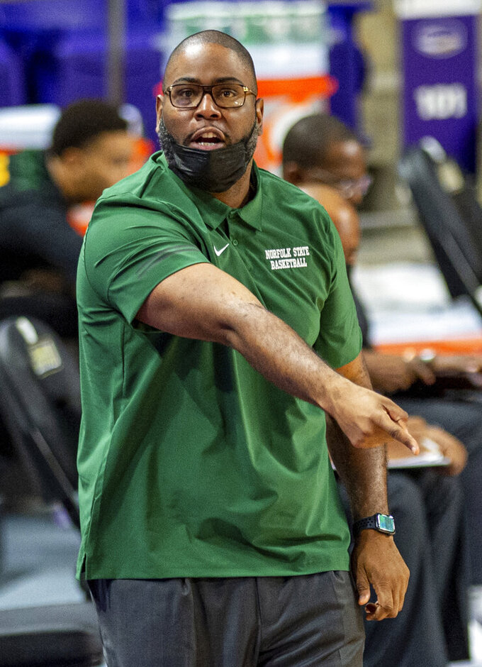 Norfolk State head coach Robert Jones directs his team during the first half of an NCAA basketball game against James Madison in Harrisonburg, Va., Friday, Nov. 27, 2020. (Daniel Lin/Daily News-Record via AP)