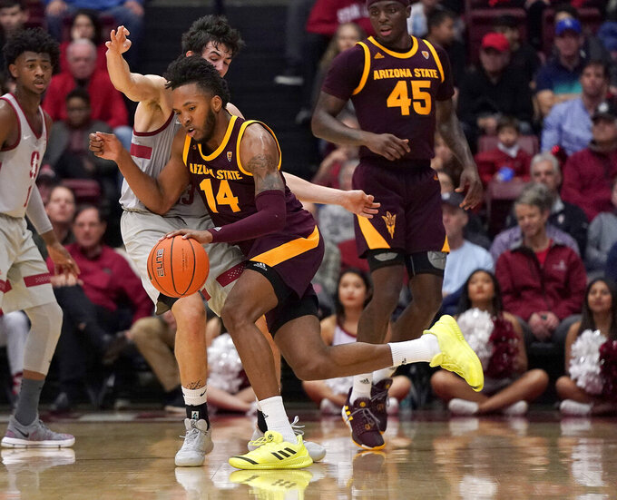 Arizona State forward Kimani Lawrence (14) drives against Stanford guard Cormac Ryan during the first half of an NCAA college basketball game in Stanford, Calif., Saturday, Jan. 12, 2019. (AP Photo/Tony Avelar)