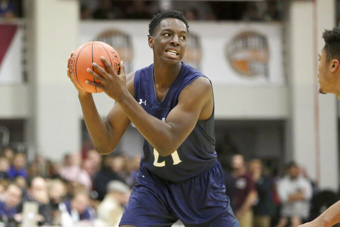 In this Jan. 13, 2018, file photo, Chino Hills Onyeka Okongwu in action against Spartanburg Day during a high school basketball game at the Hoophall Classic in Springfield, MA. Okongwu was California's Mr. Basketball as a junior and senior at nearby Chino Hills High. The 6-9, 245-pounder is an aggressive and physical defender. (AP Photo/Gregory Payan, File)