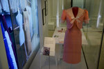 """A dress and jacket that Princess Diana changed into on her wedding day made by designer David Sassoon is displayed during a media preview for the """"Royal Style in the Making"""" exhibition at Kensington Palace in London, Wednesday, June 2, 2021. The exhibition, which opens to visitors on Thursday and runs until January 2, 2022, explores the intimate relationship between fashion designer and royal client. (AP Photo/Matt Dunham)"""