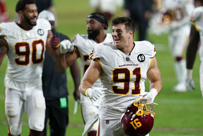 Washington Football Team defensive end Ryan Kerrigan (91) leaves the field after an NFL football game against the San Francisco 49ers, Sunday, Dec. 13, 2020, in Glendale, Ariz. Washington won 23-15. (AP Photo/Ross D. Franklin)