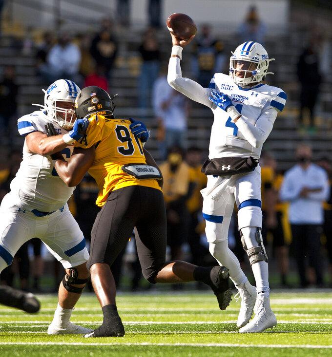 Georgia State quarterback Cornelious Brown IV throws in the first half during an NCAA football game, against Appalachian State Saturday, Nov. 14, 2020, in Boone, N.C. (Walt Unks/Winston-Salem Journal via AP)