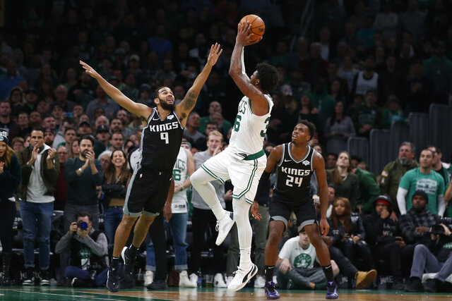 CORRECTS TO SHOOTS NOT HITS THE WINNING BASKET - Boston Celtics' Marcus Smart shoots over Sacramento Kings' Cory Joseph during the fourth quarter of an NBA basketball game Monday, Nov. 25, 2019, in Boston. (AP Photo/Winslow Townson)