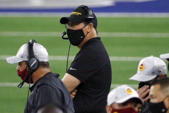 Washington Football Team head coach Ron Rivera, center, watches play against the Dallas Cowboys in the second half of an NFL football game in Arlington, Texas, Thursday, Nov. 26, 2020. (AP Photo/Roger Steinman)