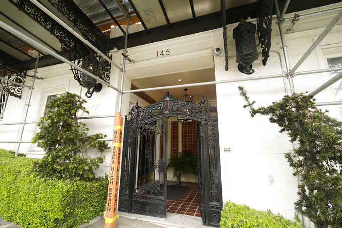 Shown is entrance to a Presidio Heights building under renovation where a wealthy couple received a record half a million dollar buyout to vacate their luxury apartment of three decades in San Francisco on Friday, July 30, 2021. The $475,000 voluntary buyout is considered to be the largest in city history underscoring the lengths some landlords will go to to get rid of long-term tenants in a city with strict rent control and soaring market rents. (AP Photo/Eric Risberg)
