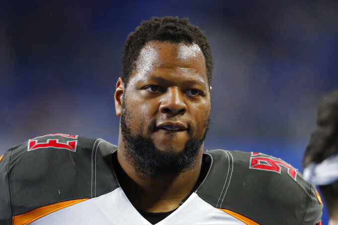 FILE - In this Dec. 15, 2019, file photo, Tampa Bay Buccaneers nose tackle Ndamukong Suh is shown on the sideline before an NFL football game against the Detroit Lions in Detroit. The Buccaneers announced Thursday, March 26, 2020, that the team had re-signed defensive lineman Ndamukong Suh. (AP Photo/Paul Sancya, File)