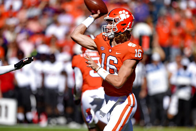 Clemson quarterback Trevor Lawrence throws a pass during the first half of an NCAA college football game against Louisville Saturday, Nov. 3, 2018, in Clemson, S.C. (AP Photo/Richard Shiro)