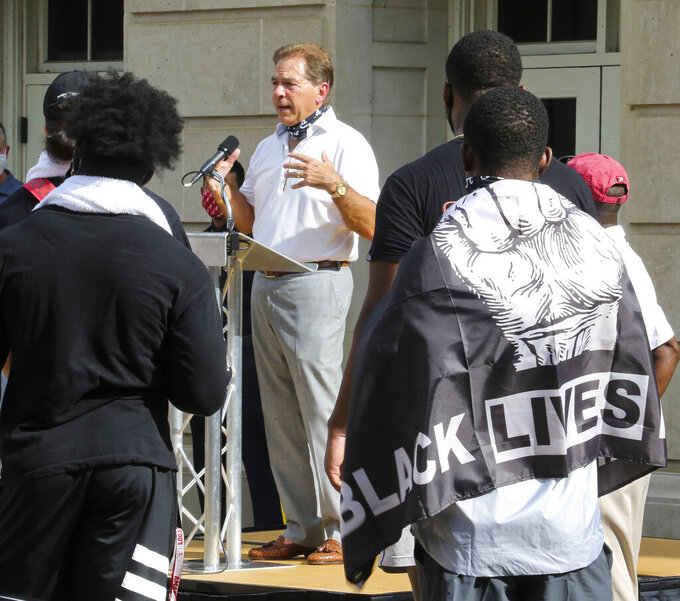 University of Alabama football Coach Nick Saban speaks at a social justice rally in front of Fosters Auditorium, the sight of the famous stand in the Schoolhouse Door to voice his support for social justice Monday, Aug. 31, 2020, in Tuscaloosa, Ala. Then Governor George Wallace made his famous stand in this doorway to attempt to prevent the integration of the university. Football players at Alabama staged the march and rally to support Black Lives Matter and issues of social justice. (Gary Cosby Jr./The Tuscaloosa News via AP)