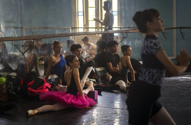 Members of the national ballet of Cuba stretch while they watch a practice directed by Viengsay Valdes in Havana, Cuba, Thursday, Dec. 12, 2019. Valdes, the new head of Cuba's legendary National Ballet, says she hopes to renew the institution after the death of long-time director Alicia Alonso by introducing new choreography and appearances by dancers who have emigrated to other companies. (AP Photo/Ramon Espinosa)