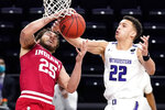 Indiana forward Race Thompson, left, and Northwestern forward Pete Nance battle for a rebound during the first half of an NCAA college basketball game in Evanston, Ill., Wednesday, Feb. 10, 2021. (AP Photo/Nam Y. Huh)