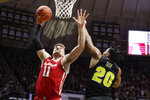 Wisconsin forward Micah Potter (11) shoots over Purdue guard Nojel Eastern (20) during the first half of an NCAA college basketball game in West Lafayette, Ind., Friday, Jan. 24, 2020. (AP Photo/Michael Conroy)