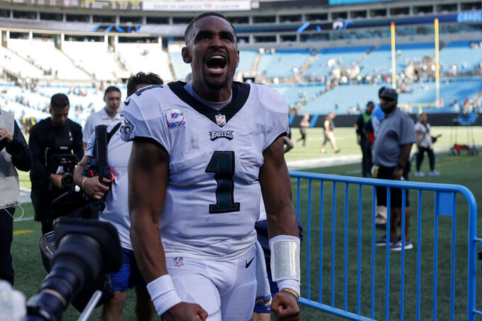 Philadelphia Eagles quarterback Jalen Hurts celebrates their win against the Carolina Panthers in an NFL football game Sunday, Oct. 10, 2021, in Charlotte, N.C. (AP Photo/Nell Redmond)