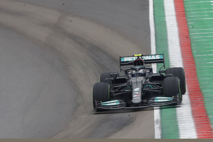 Mercedes driver Valtteri Bottas of Finland steers his car during the Emilia Romagna Formula One Grand Prix, at the Imola racetrack, Italy, Sunday, April 18, 2021. (AP Photo/Luca Bruno)