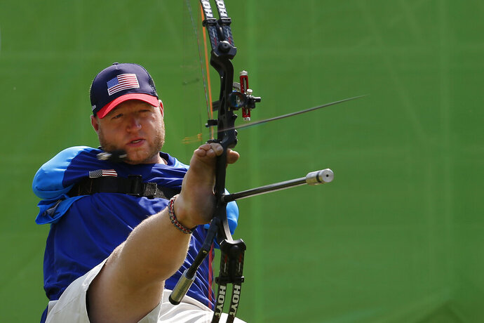 """FILE -In this Sept. 14, 2016, file photo, Matt Stutzman, of United States, holds the bow with his foot as he competes in the individual compound-open, during the Paralympic Games at the Sambadrome, in Rio de Janeiro, Brazil. Stutzman is among several Paralympic athletes who are profiled in the Nexflix documentary """"Rising Phoenix"""" that will be released in 190 countries on Wednesday, Aug. 26, 2020.(AP Photo/Silvia Izquierdo, File)"""