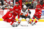Anaheim Ducks' J.T. Brown (71) carries the puck against Detroit Red Wings' Darren Helm (43) and Frans Nielsen (51) in the first period of an NHL hockey game Tuesday, Feb. 13, 2018, in Detroit. (AP Photo/Paul Sancya)