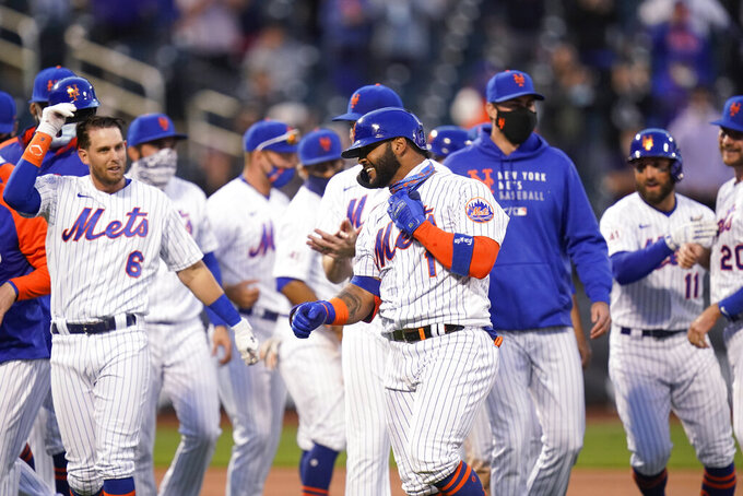 New York Mets' Jonathan Villar (1) celebrates with teammates after a baseball game against the Philadelphia Phillies in the first game of a doubleheader Tuesday, April 13, 2021, in New York. The Mets won 4-3. (AP Photo/Frank Franklin II)