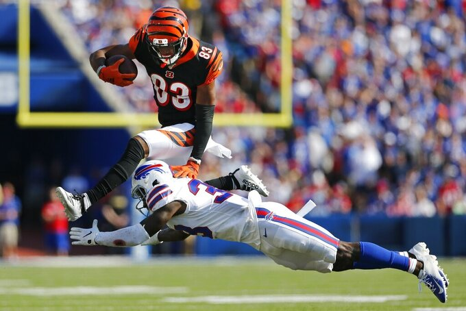 Cincinnati Bengals' Tyler Boyd (83) hurdles Buffalo Bills' Siran Neal (33) during the second half of an NFL football game Sunday, Sept. 22, 2019, in Orchard Park, N.Y. (AP Photo/John Munson)