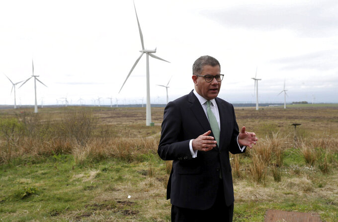 President of the 2021 United Nations Climate Change Conference, COP26, Alok Sharma prepares for a speech at Whitelee Windfarm in Glasgow, Scotland, Friday May 14, 2021.  Sharma is setting out the importance of COP26 and the UK's ambitions over the next six months, running up to hosting the Nov. 1-12 summit, bringing world leaders together to face climate change issues. (Russell Cheyne/PA via AP)