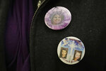Denise Ernest, the sister of missing Utah woman Susan Cox Powell, wears buttons with the photos of her sister, Susan Cox Powell, and her nephews Charlie and Braden, Tuesday, Feb. 18, 2020, during a break in a session of Pierce County Superior Court in Tacoma, Wash., on the first day of a civil lawsuit over the murder of the Charlie and Braden, who were attacked and killed by their father Josh Powell in 2012 while he was under suspicion for Susan Powell's disappearance. The parents of Susan Cox Powell allege that negligence by the Washington state Department of Social and Health Services was a contributing factor that led to the deaths of their grandsons. (AP Photo/Ted S. Warren)