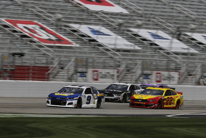 Chase Elliott (9), Aric Almirola (10) and Joey Logano (22) drive during a NASCAR Cup Series auto race at Atlanta Motor Speedway, Sunday, June 7, 2020, in Hampton, Ga. (AP Photo/Brynn Anderson)