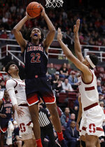 Arizona's Zeke Nnaji (22) shoots between Stanford's Jaiden Delaire, left, and Oscar da Silva during the second half of an NCAA college basketball game Saturday, Feb. 15, 2020, in Stanford, Calif. (AP Photo/Ben Margot)