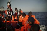 Rescue migrants look out from a rescue boat as they are taken to the Ocean Viking ship in the Mediterranean Sea, Wednesday, Sept. 18, 2019. The humanitarian ship operated by SOS Mediterranee and Doctors Without Borders pulled over 70 migrants from a rubber boat north of Libya. (AP Photo/Renata Brito)