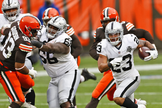 Las Vegas Raiders running back Devontae Booker (23) rushes during the first half of an NFL football game against the Cleveland Browns, Sunday, Nov. 1, 2020, in Cleveland. (AP Photo/Ron Schwane)