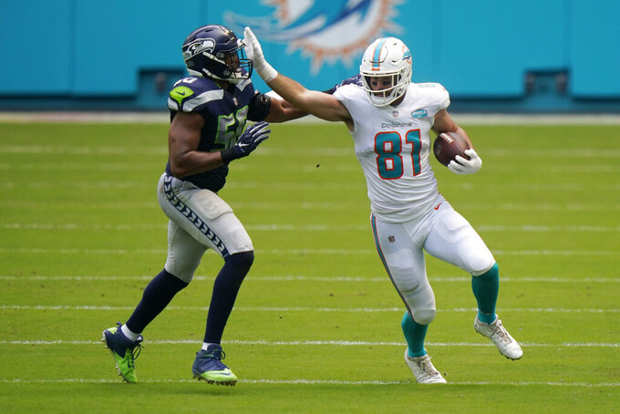 Miami Dolphins tight end Durham Smythe (81) blocks Seattle Seahawks outside linebacker K.J. Wright (50), during the first half of an NFL football game, Sunday, Oct. 4, 2020, in Miami Gardens, Fla. (AP Photo/Lynne Sladky)
