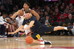 St. John's Nick Rutherford, top, and West Virginia's Chase Harler chase a loose ball during the second half of an NCAA college basketball game, Saturday, Dec. 7, 2019 in New York. St. John's won 70-68. (AP Photo/Mark Lennihan)