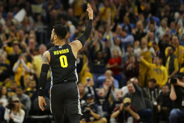 Marquette's Markus Howard reacts after making a 3-pointer during the first half of an NCAA college basketball game against Villanova Saturday, Jan. 4, 2020, in Milwaukee. (AP Photo/Aaron Gash)