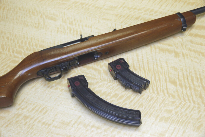 FILE - In this June 27, 2017, file photo, a semi-automatic rifle is displayed with a 25 shot magazine, left, and a 10 shot magazine, right, at a gun store in Elk Grove, Calif. A three-judge panel of the 9th U.S. Circuit Court of Appeals has thrown out California's ban on high-capacity ammunition magazines. The panel's majority ruled Friday, Aug. 14, 2020, that the law banning magazines holding more than 10 bullets violates the constitutional right to bear firearms. (AP Photo/Rich Pedroncelli, File)