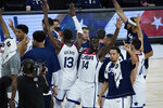 United States players celebrate after defeating Spain in an exhibition basketball game in preparation for the Olympics, Sunday, July 18, 2021, in Las Vegas. (AP Photo/John Locher)