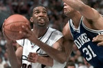 FILE - In this March 29, 1999, file photo, Connecticut's Richard Hamilton looks for a shot as he is defended by Duke's Shane Battier (31) in the second half of the NCAA college basketball Final Four championship game in St. Petersburg, Fla. UConn defeated Duke 77-74. (AP Photo/Eric Draper, File)