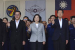 Taiwan President Tsai Ing-wen, center, poses for photos at the Penghu Magong military air base in outlying Penghu Island, Taiwan Tuesday, Sept. 22, 2020. Tsai visited the military base on one of Taiwan's outlying islands Tuesday in a display of resolve following a recent show of force by rival China. (AP Photo/Wu Huizhong)