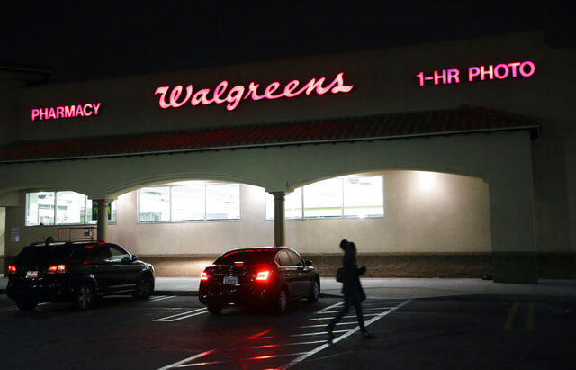 FILE - This June 24, 2019 file photo shows an exterior view of a Walgreens store in Los Angeles. Walgreens will pay $7.5 million to settle with California authorities after an employee was criminally charged with impersonating a pharmacist and illegally filling more than 745,000 prescriptions in the San Francisco Bay Area. Kim Thien Le has pleaded not guilty to felony impersonation charges. (AP Photo/Marcio Jose Sanchez,File)