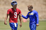 Los Angeles Rams' Matthew Stafford talks with head coach Sean McVay after an NFL football practice in Thousand Oaks, Calif., Thursday, May 27, 2021. (AP Photo/Kelvin Kuo)