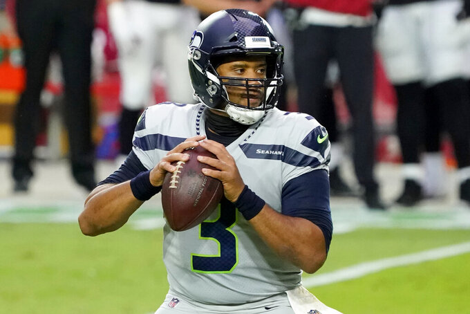 Seattle Seahawks quarterback Russell Wilson (3) looks to pass against the Arizona Cardinals during the first half of an NFL football game, Sunday, Oct. 25, 2020, in Glendale, Ariz. (AP Photo/Rick Scuteri)