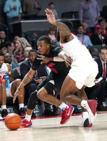 Southern Methodist's Jahmal McMurray (0) tries to drive around Houston's Corey Davis Jr. during the first half of an NCAA college basketball game Thursday, March 7, 2019, in Houston. (AP Photo/David J. Phillip)
